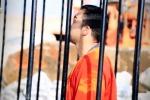 Pilota giordano bruciato vivo in gabbia, le immagini dell'orrore - Foto