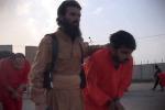 """Isis, curdi sfilano in gabbia: """"Li decapiteremo tutti"""" - Foto"""