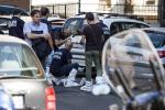 Trovato un cadavere per strada dentro un sacco