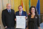 Nelle foto, al centro, Nicolò Curella