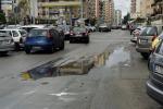 Palermo, un acquazzone basta per allagare via Botticelli e i rifiuti di via Lanza di Scalea