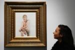Dipinge Trump nudo, artista rischia di finire in tribunale