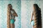 Giovane russa non taglia i capelli da 13 anni: impazza sul web la sua chioma da record