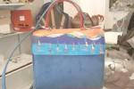 Una borsa Sisili con raffigurazione di Francesco Anastasi