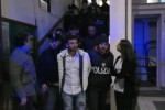 L'uscita degli arrestati dalla squadra mobile