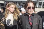 Johnny Depp chiude il divorzio: ad Amber Heard 7 milioni e i cani