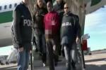 Un fermo immagine tratto da un video della polizia mostra l'eritreo Fitiwi Negash, estradato dalla Germania in Italia - Ansa