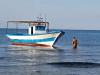 Sbarco a Porto Empedocle, il barcone arriva davanti alla spiaggia - Video