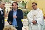 Micari e Orlando parlano a fine messa in una chiesa di Palermo, è polemica