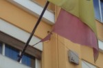 Un'Isola a brandelli come la sua bandiera