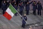 Arianna Fontana carries the flag of Italy during the opening ceremony of the 2018 Winter Olympics in Pyeongchang, South Korea, Friday, Feb. 9, 2018. (Sean Haffey/Pool Photo via AP) [CopyrightNotice: Copyright 2018 The Associated Press. All rights reserved]
