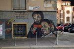 Falcone punta la pistola a Borsellino: lo sfregio sul murales di Milano, individuato l'autore