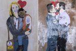 Il bacio tra Salvini e Di Maio, la Meloni con un bimbo africano: giallo su due murales comparsi a Roma