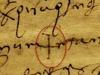Pisa, anno 730 (gennaio), contratto di vendita su pergamena: simbolo grafico elementare (croce greca) tracciato da un venditore analfabeta longobardo, il chierico Candidus, nella sottoscrizione scritta a suo nome dal notaio Ansolf (fonte: A. Ghignoli)