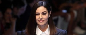 Italian actress Monica Bellucci presents a creation by Dolce and Gabbana during the Milan Fashion Week, in Milan, Italy, 16 June 2018. The Spring-Summer 2019 Men's collections are presented at the Milano Moda Uomo from 15 to 18 June.ANSA / MATTEO BAZZI