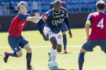 epa06786688 Jamaican sprint legend Usain Bolt (R) and Norway's U19 player Fredrik Horn Myhre in action during the friendly soccer match between Stromsgodset and Norway's U19 at Marienlyst Stadium in Drammen, Norway, 05 June 2018. EPA/RUUD VIDAR NORWAY OUT