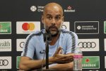 Manchester City coach Pep Guardiola answered questions during a news conference for Saturday's International Champions Cup soccer match against FC Bayern, Friday, July 27 2018, in Miami Gardens, Fla. (Pedro Portal/Miami Herald via AP)
