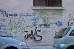 I muri imbrattati in via Donizzetti, Palermo