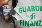 """Carte da """"Uno"""" contraffatte e marchi falsi, maxi sequestro in un grande magazzino a Partinico"""