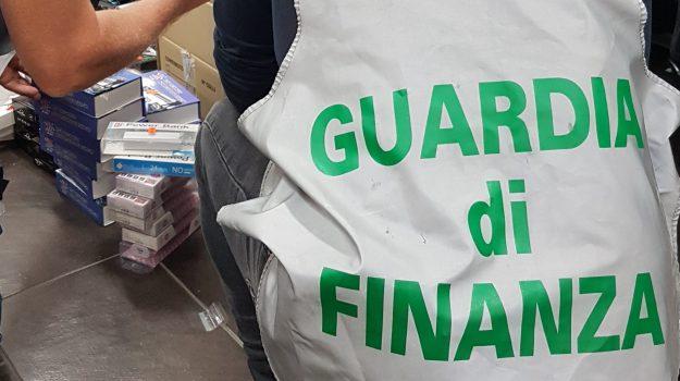 contraffazione partinico, guardia di finanza, sequestro grande magazzino partinico, Palermo, Cronaca