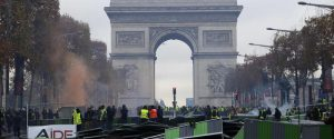 A barricade is set up on the Champs-Elysees avenue, with the Arc de Triomphe in background, during a demonstration against the rising of the fuel taxes, Saturday, Nov. 24, 2018 in Paris. French police fired tear gas and water cannons to disperse demonstrators in Paris Saturday, as thousands gathered in the capital and staged road blockades across the nation to vent anger against rising fuel taxes and Emmanuel Macron's presidency. (ANSA/AP Photo/Michel Euler) [CopyrightNotice: Copyright 2018 The Associated Press. All rights reserved.]
