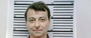 Un'immagine di Cesare Battisti al momento del suo arresto in Brasile