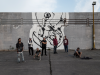 Murales al porto di Giardini Naxos: l'opera di Bucchi nel segno dell'integrazione