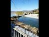 Crolla un ponte sul fiume Magra, due furgoni precipitano sulla strada collassata