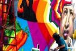 Hugo Chavez ritratto nei graffiti per le strade di Caracas