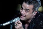 Robbie Williams: mi riprendo la corona da Re del pop
